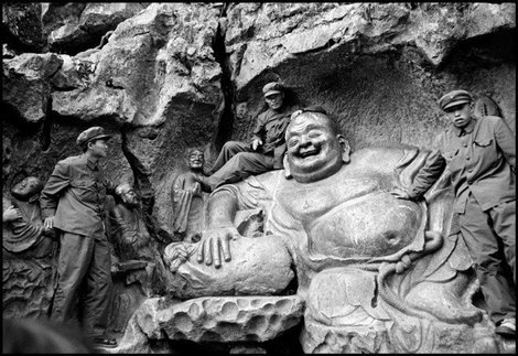 PLA soldiers on a Yuan Dynasty statue of a Maitraya, West Lake near Hangzhou, China, 1978 Inge Morath Foundation Magnum Fhotos