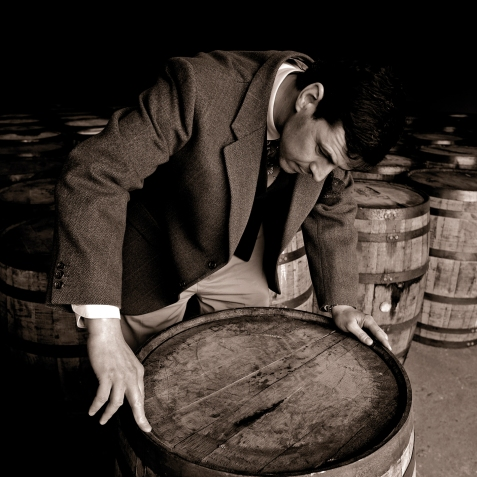 04-dr-bill-lumsden-director-of-whisky-creation-at-glenmorangie-inspecting-a-cask
