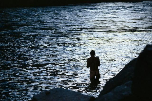 silhouetted-man-bathing-in-the-colorado-kate-thompson