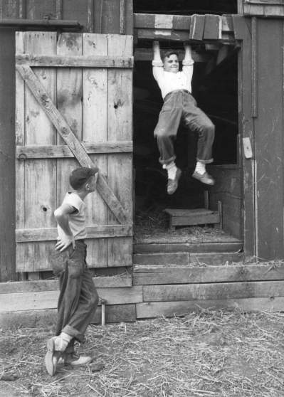 What I Did on My Vacation: Mac Fry and Pres Lewellen swinging from hayloft during summer vacation.