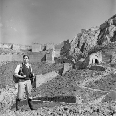 fulbright-scholar-and-archaeology-student-kevin-andrews-standing-in-front-of-castle-ruins